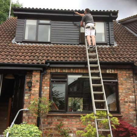 Exterior Property Decorating in Whetstone, all completed on ladders.
