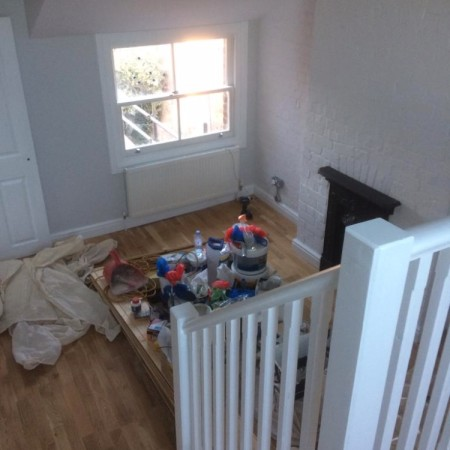 North London loft conversion including: plaster boarding, plastering, carpentry, painting & MDF inbuilt cupboards